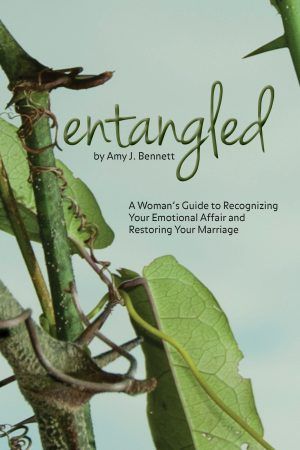 The words entangled are designed to look like branches. The thorns are specifically placed to show how messy marriage can be.